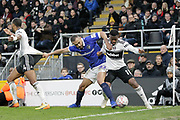 Oldham Athletic midfielder Johan Branger (22) wrestles with Fulham defender Denis Odoi (4) and Fulham forward Floyd Ayite (11) during The FA Cup 3rd round match between Fulham and Oldham Athletic at Craven Cottage, London, England on 6 January 2019.
