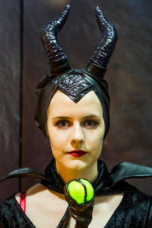 Amy Hardie (pictured), 19, from Harpenden plays Maleficent in a costume she made totally herself. She has travelled into the show with her friend (who she met at school) Courtney Barret, 20, who plays Edward Scissor Hands. London Film and Comic Con 2014, (LFCC), at Earls Court, London, UK.