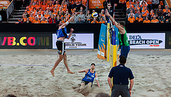 06-01-2019 NED: Dela Beach Open, Den Haag<br /> Netherlands lost the bronze medal from Russia 1-2 /  Robert Meeuwsen #2 and block Konstantin Semenov #2 RUS. Alexander Brouwer #1 sitting on the ground