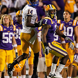 October 16, 2010; Baton Rouge, LA, USA; LSU Tigers cornerback Patrick Peterson (7) in coverage against McNeese State Cowboys wide receiver Damion Dixon (14) during a game at Tiger Stadium. LSU defeated McNeese State 32-10. Mandatory Credit: Derick E. Hingle