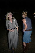 Donna Air and Sara Cox. Topshop Fashion Show and party. Berkeley Sq. London. 19  September 2005. ONE TIME USE ONLY - DO NOT ARCHIVE © Copyright Photograph by Dafydd Jones 66 Stockwell Park Rd. London SW9 0DA Tel 020 7733 0108 www.dafjones.com