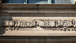 """Exterior of Central Library with feature """"Let There Be Light"""" above entrance in Edinburgh Old Town, Scotland, UK"""