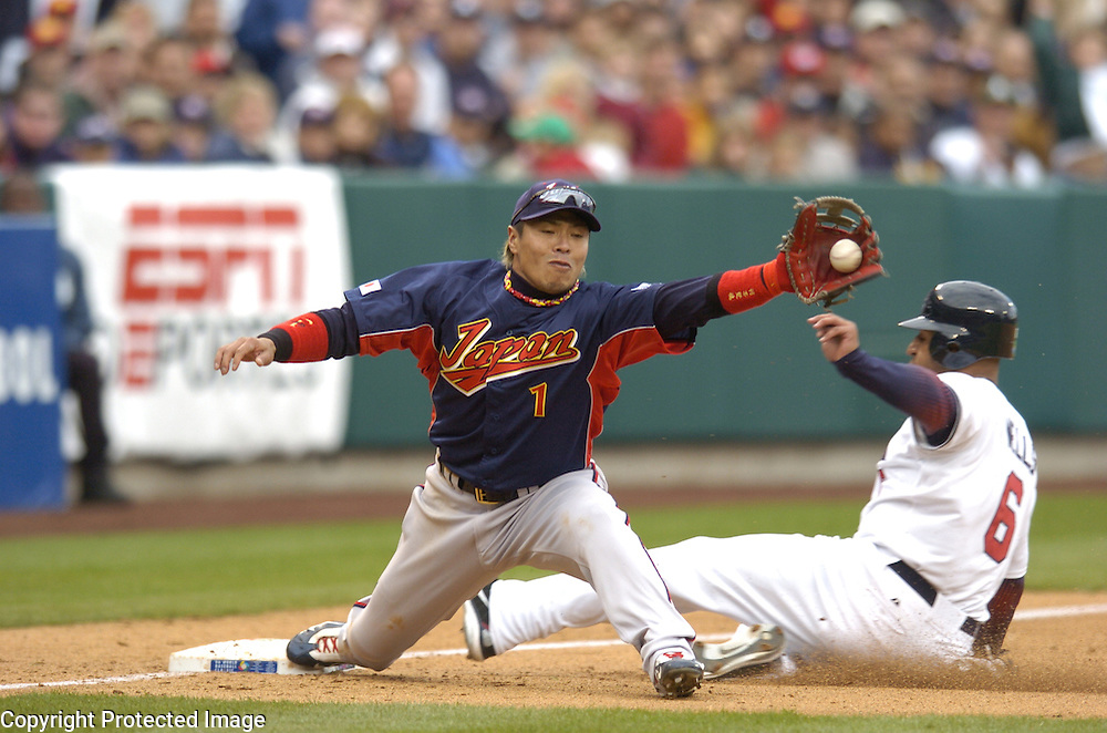 Team USA's Vernon Wells is out at third base in the 9th inning against Team Japan in Round 2 action at Angel Stadium of Anaheim. Making the play for Team Japan is Akinori Iwamura.
