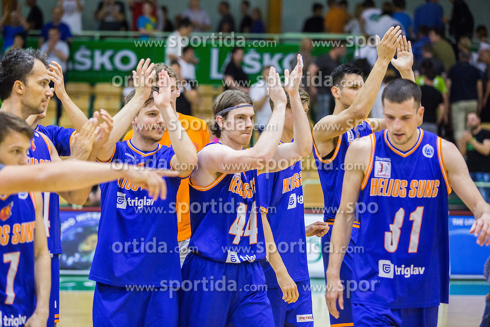 Players of KK Helios Suns celebrating their win after the basketball match between KK Zlatorog and KK Helios Suns in 1st match of Nova KBM Slovenian Champions League Final 2015/16 on May 29, 2016  in Dvorana Zlatorog, Lasko, Slovenia.  Photo by Ziga Zupan / Sportida