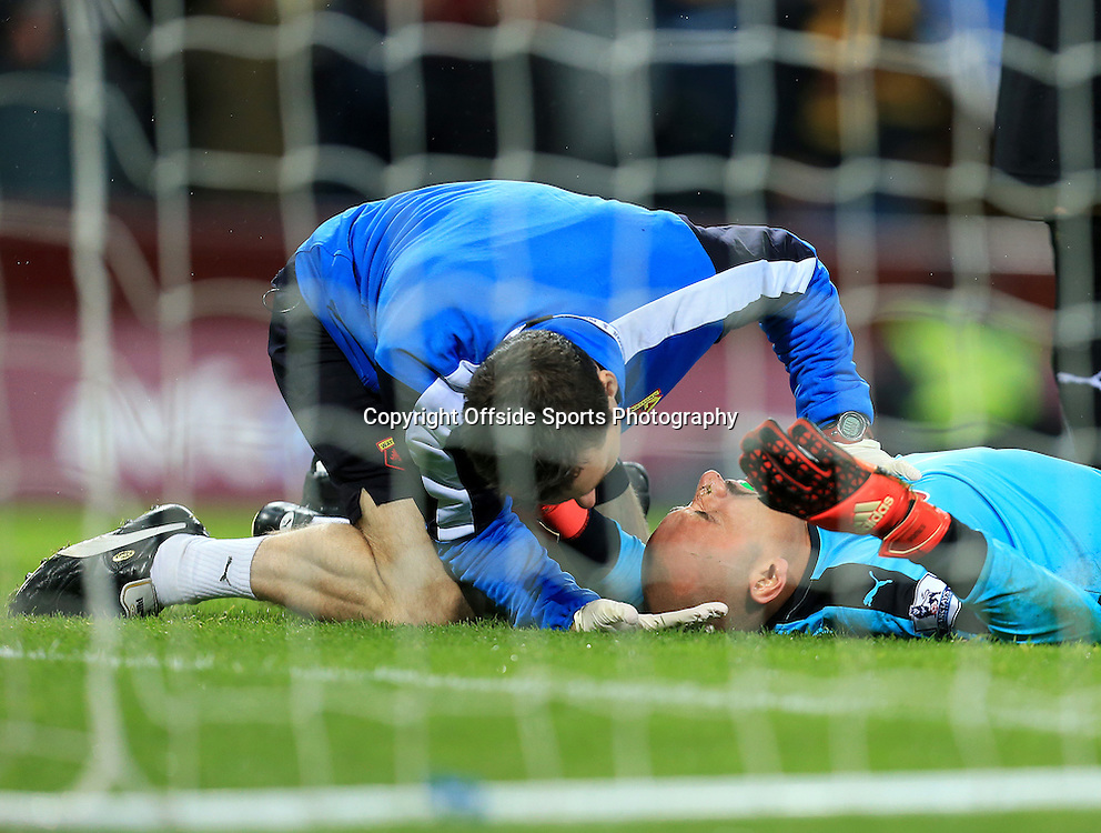 28th November 2015 - Barclays Premier League - Aston Villa v Watford -     Heurelho Gomes of Watford receives medial treatment after a head injury in the second half - Photo: Paul Roberts / Offside.