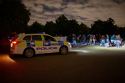 © Licensed to London News Pictures. 06/10/2019. London, UK. A police car parks next to an Extinction Rebellion camp in Hyde Park . Tomorrow they intend to block roads in and around Westminster. Photo credit: George Cracknell Wright/LNP