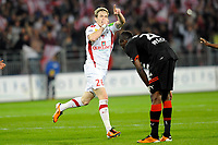 FOOTBALL - FRENCH CHAMPIONSHIP 2010/2011 - L1 - STADE RENNAIS v STADE BRESTOIS - 9/04/2011 - PHOTO PASCAL ALLEE / DPPI - JUBILATION NOLAN ROUX (BREST) CONTRASTE WITH DESPERATE TONGO HAMED DOUMBIA RENNES PLAYERS