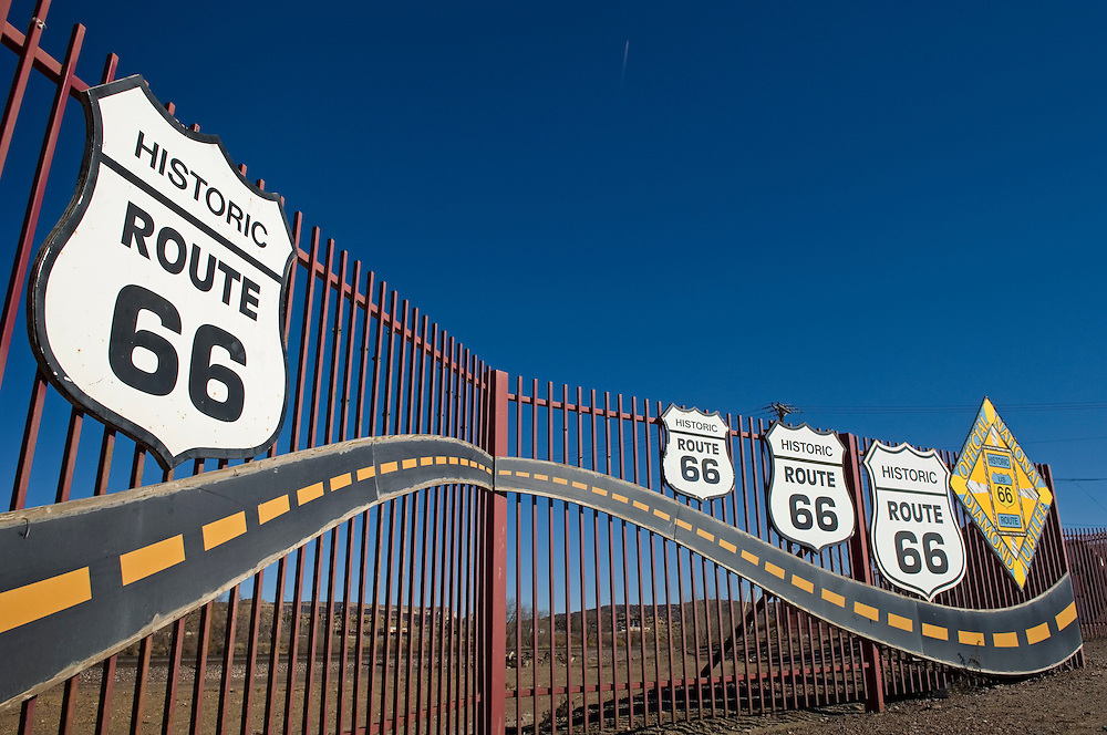 Historic Route 66 signs on fence in Gallup, New Mexico.