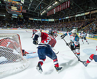 KELOWNA, CANADA - MARCH 28: Chance Braid #22 of Kelowna Rockets skates behind the net while checked by Riley Hillis #3 of Tri-City Americans on March 28, 2015 at Prospera Place in Kelowna, British Columbia, Canada.  (Photo by Marissa Baecker/Shoot the Breeze)  *** Local Caption *** Riley Hillis; Chance Braid;