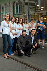 Chesterfield Specsavers Exceptional number of Staff Members Pregnant - left to right Allisia Charlesworth, Beth Ralph, Claire Wildman, Anna Nelson, Lindsey Wright and Kaitie Care with Daughter Lucy and Dan Bennett with Son Oliver..Front Dads To Be Monoj Harrah and Matt Lee.  24 June 2010 .Images © Paul David Drabble.