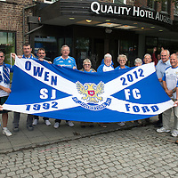 Rosenborg v St Johnstone....18.07.13  UEFA Europa League Qualifier.<br /> St Johnstone fans with a flag dedicated to the memory of Owen Ford pictured in Trondheim which will be displayed at St Johnstone's Europa League Qualifier against Rosenborg.<br /> Picture by Graeme Hart.<br /> Copyright Perthshire Picture Agency<br /> Tel: 01738 623350  Mobile: 07990 594431