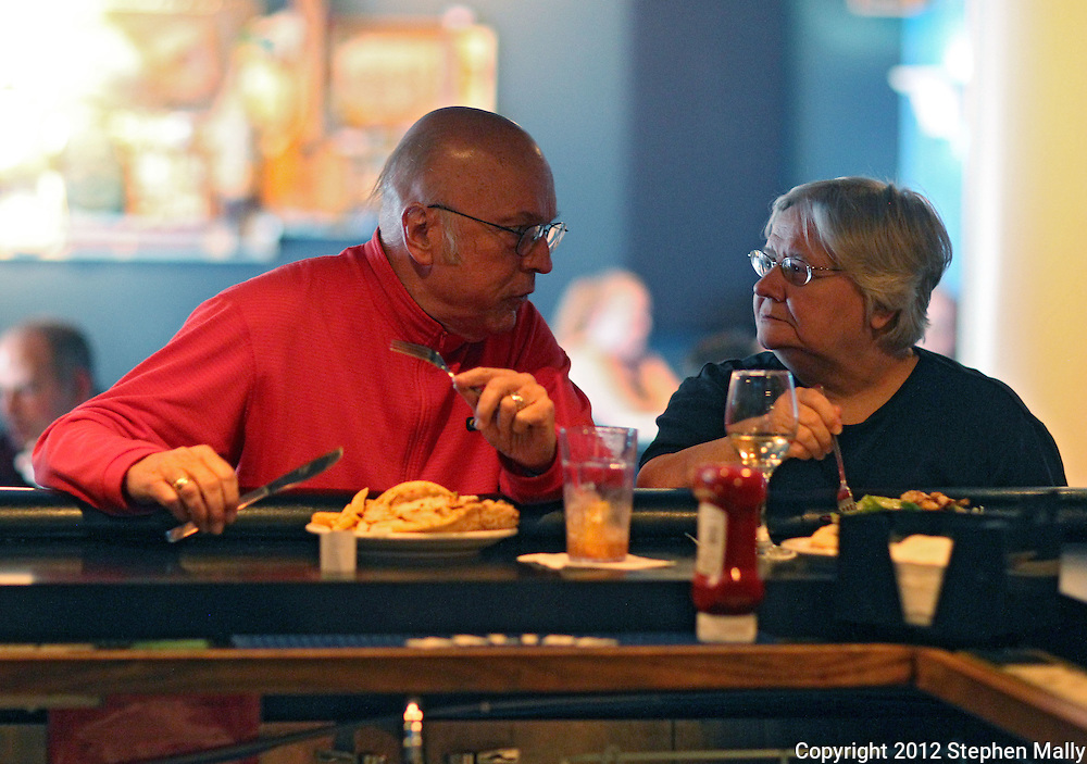 Bill Thomas (from left) talks with his wife, Julianne, of Cedar Rapids as they eat dinner at Vernon Inn, 2874 Mount Vernon Road SE, in Cedar Rapids on Tuesday evening, May 15, 2012. The Thomas' have been regular customers for all 36 years. (Stephen Mally/Freelance)