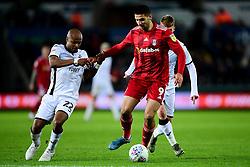 Aleksandar Mitrovic of Fulham is challenged by Andre Ayew of Swansea City - Mandatory by-line: Ryan Hiscott/JMP - 29/11/2019 - FOOTBALL - Liberty Stadium - Swansea, England - Swansea City v Fulham - Sky Bet Championship