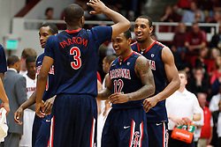 February 3, 2011; Stanford, CA, USA;  Arizona Wildcats guard/forward Kevin Parrom (3) celebrates with guard Lamont Jones (12) and forward Derrick Williams (back) during the second half against the Stanford Cardinal at Maples Pavilion.  Arizona defeated Stanford 78-69.