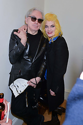 CHRIS STEIN and PAM HOGG at a private view of Chris Stein/Negative: Me, Blondie And The Advent Of Punk, held at Somerset House, The Strand, London on 5th November 2014.