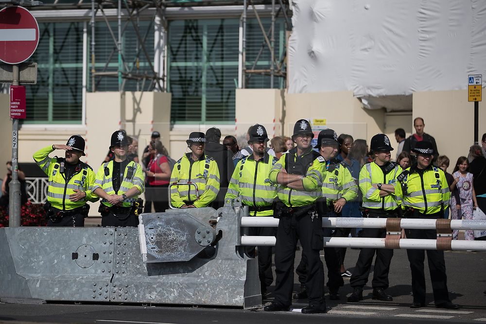 © Licensed to London News Pictures . 24/09/2017. Brighton, UK. Police line the street outside the conference entrance as a protest passes the venue . The first day of the Labour Party Conference in and around The Brighton Centre . Photo credit: Joel Goodman/LNP