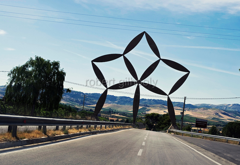 """Photos shows the """"Ingresso al Belece"""" sculpture by Pietro Consagra at the entrance to the new town of Gibellina Nuovo, Sicily.  The old town, today known as Ruderi di Gibellina, was destroyed by an earthquake in 1968 and all surviving residents relocated to the New Town 10 km away."""