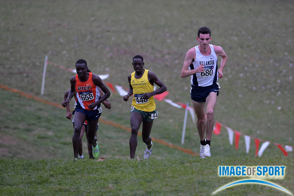 Nov 21, 2015; Louisville, KY, USA; Patrick Tiernan of Villanov (680), Edward Cheserek of Oregon (448) and Anthony Rotich of UTEP lead the field during the 2015 NCAA cross country championships at Tom Sawyer Park.
