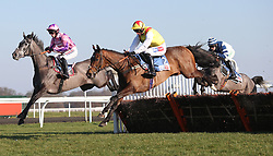 Southfield Stone and Harry Cobden (left) clear an early flight before winning The Sky Bet Dovecote Novices Hurdle Race run at Kempton Park Racecourse.