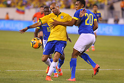 Sep 9, 2014; East Rutherford, NJ, USA; Brazil forward Diego Tardelli (9) runs with the ball past Ecuador midfielder Luis Canga (20) during the first half at MetLife Stadium.