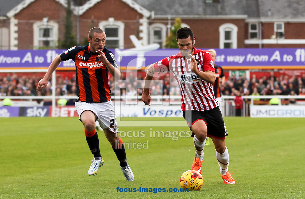 Jimmy Keohane (right) of Exeter City and Michael Harriman (left) of Luton Town battle for the ball during the Sky Bet League 2 match at St James' Park, Exeter<br /> Picture by Tom Smith/Focus Images Ltd 07545141164<br /> 01/11/2014
