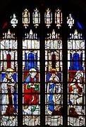 Sixteenth century stained glass windows inside church of Saint Mary, Fairford, Gloucestershire, England, UK - window 17 Saints John, Luke, Mark, Matthew