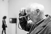 "HAMBURG, GERMANY - OCTOBER 23, 2014: Legendary Magnum Photographer Thomas Höpker at the opening of the exhibition ""Augen Auf! - 100 Years of Leica"" at the Deichtorhallen Museum of Photography."