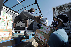 South Africa - Cape Town - 4 June 2020 - Siya Kolisi gives a hand. The DHL Stormers players helped unpack nearly a ton and half of food from a truck at Neighbourhood Old Age Homes (NOAH) in Woodstock on Thursday morning. This team effort included captain Siya Kolisi, Steven Kitshoff, Scarra Ntubeni, Damian Willemse and Dillyn Leyds. NOAH supports more than 750 pensioners who live on social grants. Photographer: Armand Hough/African News Agency(ANA)