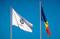 Bra?ov and Romania Flags against a blue sky in the Transylvania region.