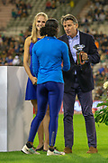 Lord Sebastian Coe, President of the IAAF presents the 2019 Diamond League Trophy for the Women's 100m to Dina Asher-Smith (Great Britain) at the IAAF Diamond League event at the King Baudouin Stadium, Brussels, Belgium on 6 September 2019.