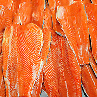 Salmon Fillets Displayed at Fish Market in Puerto Montt, Chile<br /> Until recently, the aquaculture of Chile was the world&rsquo;s second largest producer of salmon like these exquisite fillets. Most of these fish farms are in Chile&rsquo;s Los Largos Region which is where this fish market is located in Puerto Montt.  However, the industry was struck with an outbreak of a viral disease called infectious salmon anemia virus, resulting in a 75% drop in production.