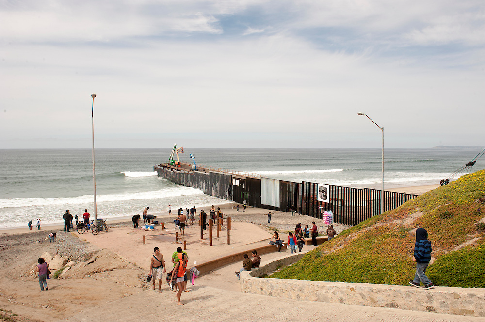 The border in Playas de Tijuana, Mexico, on the Atlantic Ocean, as seen from Mexico. The border here is frequented by many visitors over the weekends.<br /> <br /> LA FRONTERA: Artists along the US Mexican Border.<br /> &copy; Stefan Falke<br /> www.stefanfalke.com