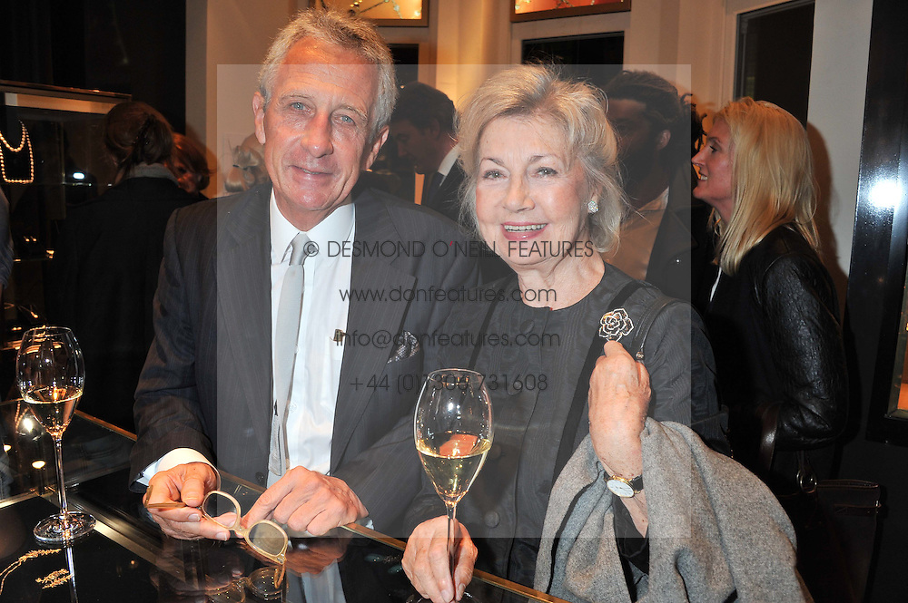 Writer ROBERT LACEY and his wife LADY JANE LACEY, widow of Lord Rayne at a private view of an exhibition 'Outside in Chelsea' held at Annoushka, 41 Cadogan Gardens, London SW3 on 2nd October 2012.