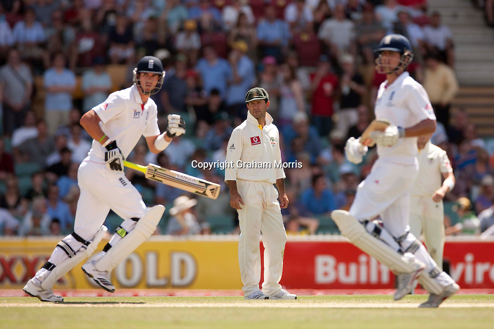Captain Ricky Ponting watches Kevin Pietersen and Alastair Cook (right) run during the second Ashes Test Match between Australia and England at the Adelaide Oval. Photo: Graham Morris (Tel: +44(0)20 8969 4192 Email: sales@cricketpix.com) 4/12/10