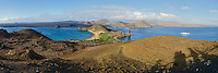 Panorama of tuff and cinder cones on Santigo Island from the top of Bartolome Island in Galapagos National Park and Marine Reserve, Ecuador.