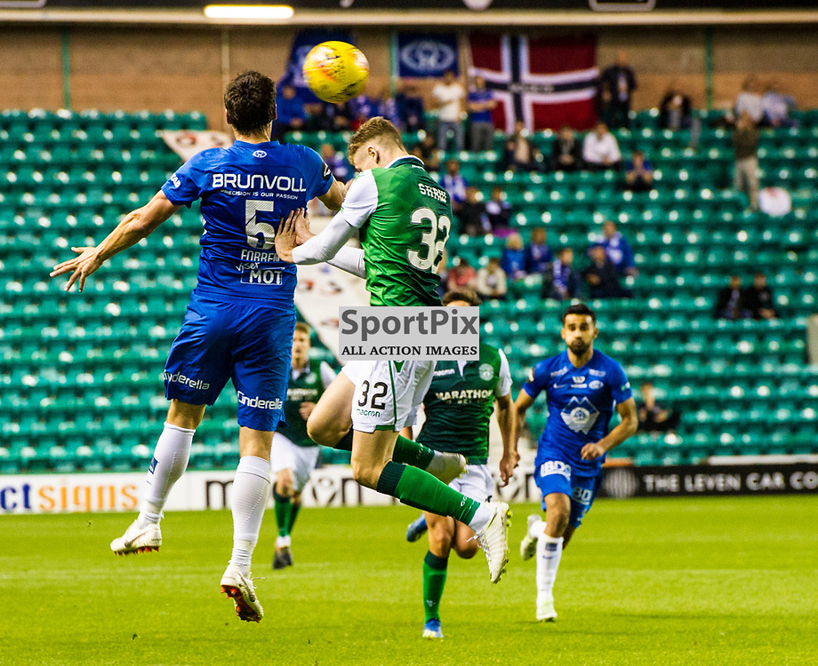 Pictured: Oli Shaw challenged Stian Gregersen for the ball<br /> <br /> Hibs welcomed Molde to Easter Road for their second home game of the Europa League campaign