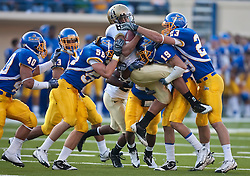 October 10, 2009; San Jose, CA, USA;  Idaho Vandals running back Kama Bailey (8) is tackled by San Jose State Spartans cornerback Peyton Thompson (19), linebacker Braden Storaasli (56), and wide receiver James Orth (23) on a kick return during the first quarter at Spartan Stadium.  Idaho won 29-25.