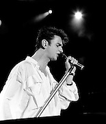 Depeche Mode performing live at Pasadena Rose Bowl, June 1988.