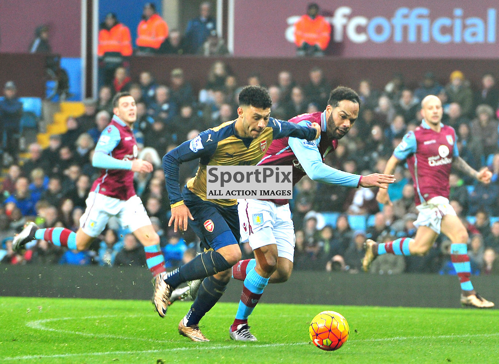 Arsenal's Alex Oxlade-Chamberlain gets away from Villa Captain Joleon Lescott......(c) BILLY WHITE | SportPix.org.uk