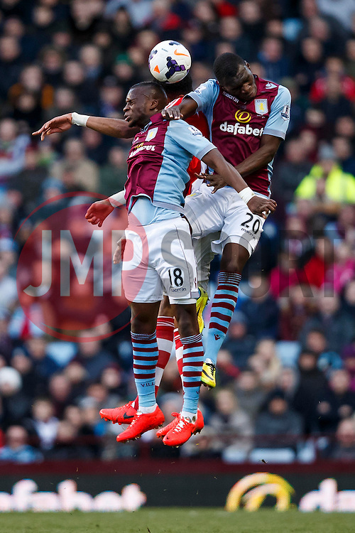 Aston Villa Midfielder Yacouba Sylla (MLI), Forward Christian Benteke (BEL) ans Stoke Midfielder Steven N'Zonzi (FRA) compete in the air - Photo mandatory by-line: Rogan Thomson/JMP - 07966 386802 - 23/03/2014 - SPORT - FOOTBALL - Villa Park, Birmingham - Aston Villa v Stoke City - Barclays Premier League.