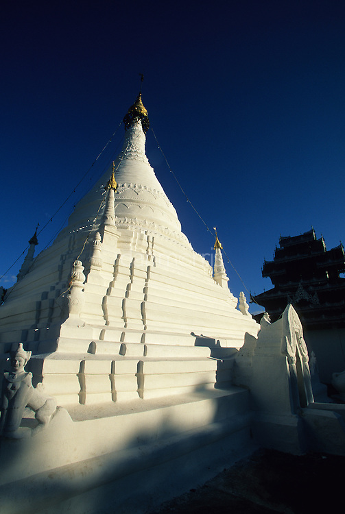 Wat Phra That Doi Kong Mu temple under blue skies in evening light, Mae Hong Son, Thailand