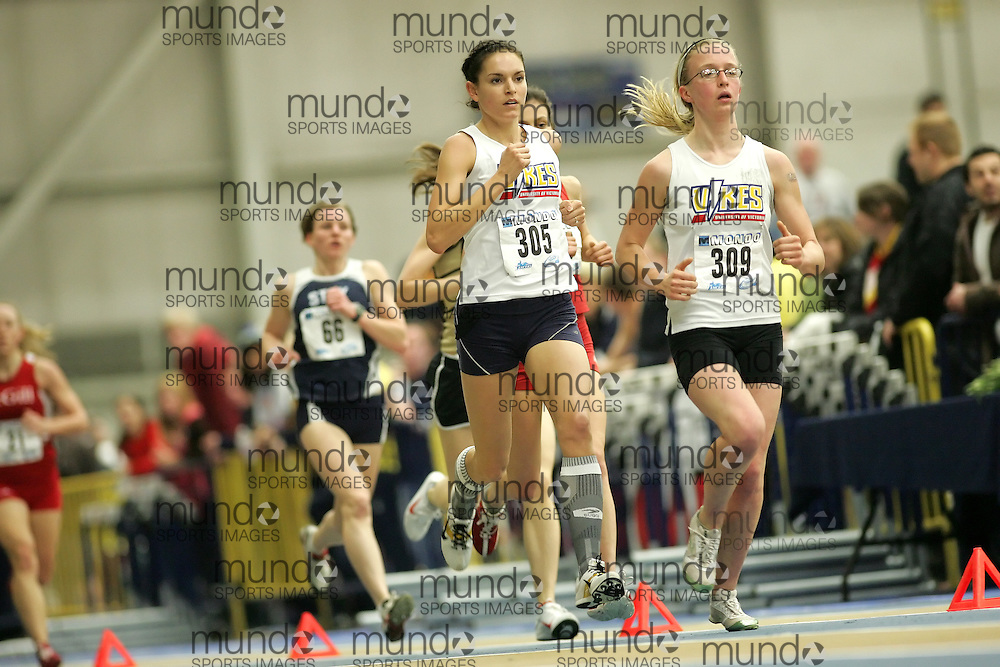 (Windsor, Ontario---12 March 2010) Claire Jean of University of Victoria   Julia Tschanz of University of Victoria   competes in the 3000m final at the 2010 Canadian Interuniversity Sport Track and Field Championships at the St. Denis Center. Photograph copyright Sean Burges/Mundo Sport Images. www.mundosportimages.com