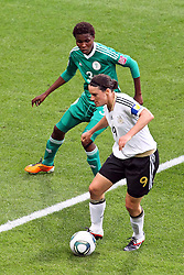 30.06.2011, Commerzbank Arena, Frankfurt, GER, FIFA Women Worldcup 2011, Gruppe A, Deutschland (GER) vs. Nigeria (NGA), im Bild:  Birgit Prinz (GER #09, Frankfurt) gegen Osinachi Ohale (Nigeria #3)..// during the FIFA Women Worldcup 2011, Pool A, Germany vs Nigeria on 2011/06/30, Commerzbank Arena, Frankfurt, Germany.  EXPA Pictures © 2011, PhotoCredit: EXPA/ nph/  Mueller *** Local Caption ***       ****** out of GER / CRO  / BEL ******