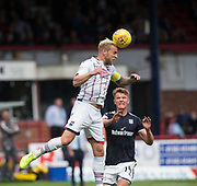 August 5th 2017, Dens Park, Dundee, Scotland; Scottish Premiership; Dundee versus Ross County; Ross County's Andrew Davies heads clear while Dundee's Mark O'Hara watches