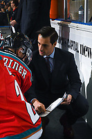 KELOWNA, CANADA - NOVEMBER 21: Assistant coach Travis Crickard goes over a play on the bench with Erik Gardiner #11 of the Kelowna Rockets against the Regina Pats  on November 21, 2018 at Prospera Place in Kelowna, British Columbia, Canada.  (Photo by Marissa Baecker/Shoot the Breeze)