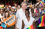New York City Mayor Bill de Blasio and his wife  in front of the Stonewall Inn at the Pride March in New York City, New York on June 25, 2017.