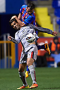 VALENCIA, SPAIN - FEBRUARY 25: (U) Loukas Vyntra of Levante UD competes for the ball with (D) Masoud Shojaei of Club Atletico Osasuna during the Liga BBVA between Levante UD and Club Atletico Osasuna at the Ciutat de Valencia stadium on February 25, 2013 in Valencia, Spain. (Photo by Aitor Alcalde Colomer).