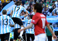 Argentina's midfielder Lionel Messi (C) celebrate with his teammates after scoring his goal against Korea Republic during the World Cup South Africa 2010 soccer match, at Soccer City stadium, in Johannesburgo, South Africa, on June 17, 2010.  (Alejandro Pagni/PHOTOXPHOTO)