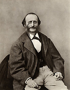 Jacques Offenbach (1819-1880) born Jakob Levy Eberst Offenbach at Cologne. German-born French opera-comique composer and conductor.  From a photograph by Nadar, pseudonym of Gaspard-Felix Tournachon (1820-1910).