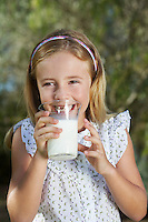 Portrait of girl (5-6) drinking milk